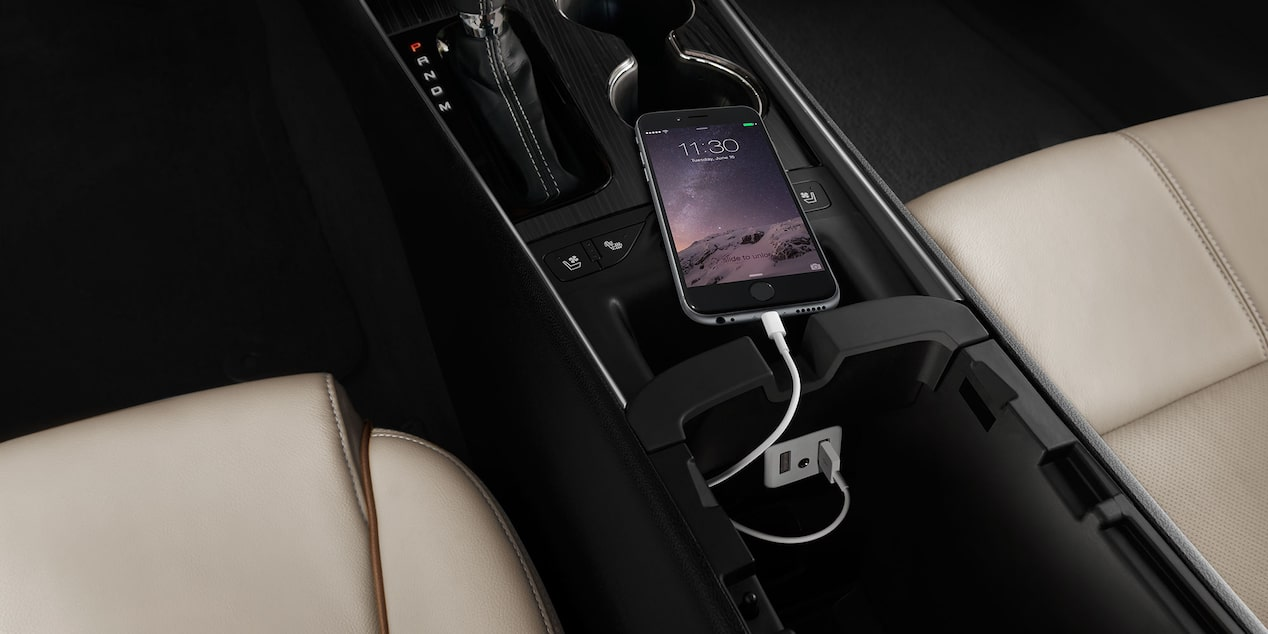 Chevrolet Impala technology: mobile connectivity and charging capability.