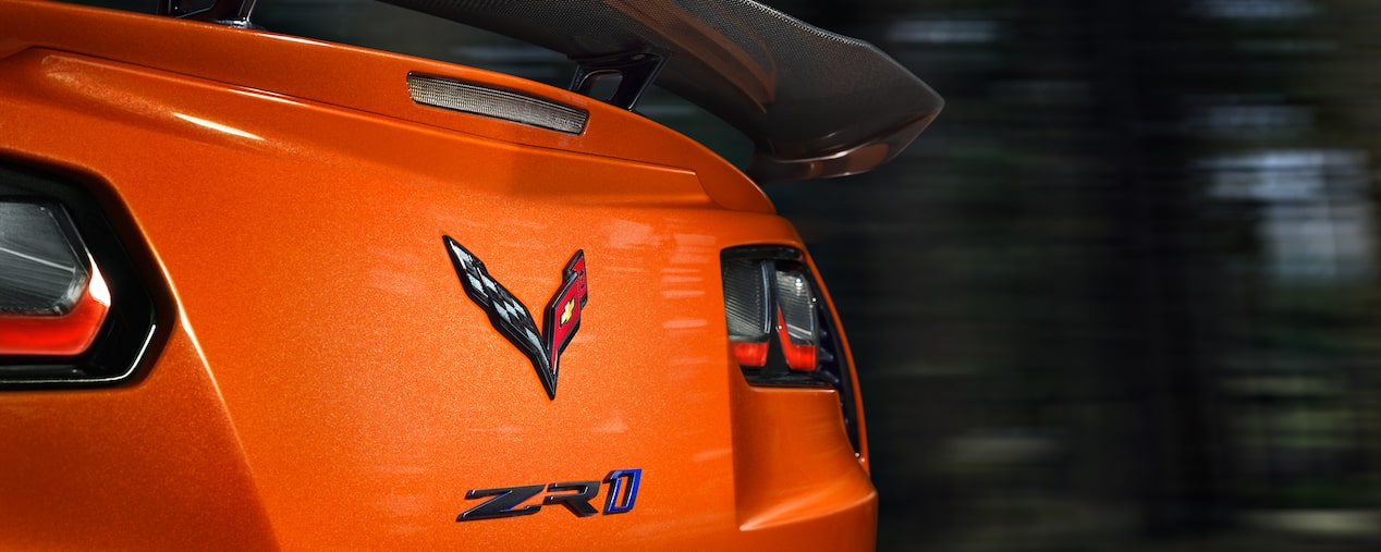 Exterior of the Corvette ZR1 supercar in Sebring Orange Tintcoat: rear profile.