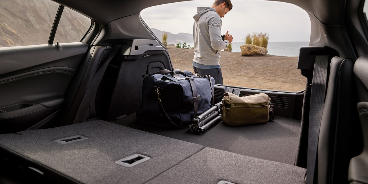 Convenience features of the 2019 Chevrolet Cruze interior, showing spacious cargo room with passenger seats.