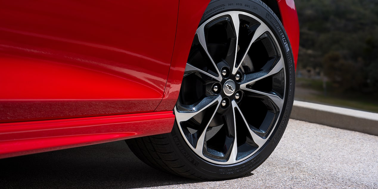 Side profile of the 2019 Chevrolet Cruze compact car with stylish wheels.