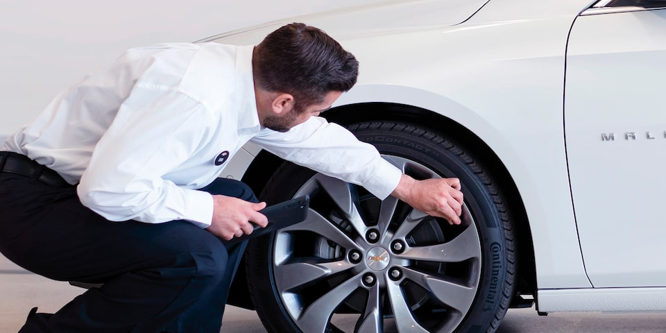 Certified Service Expert checks a vehicle.