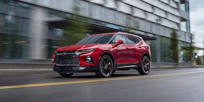 2021 Chevrolet Blazer mid-size SUV: driving down city street.