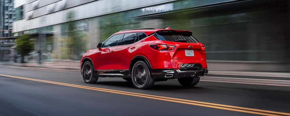 2021 Chevrolet Blazer mid-size SUV: driving down the street.