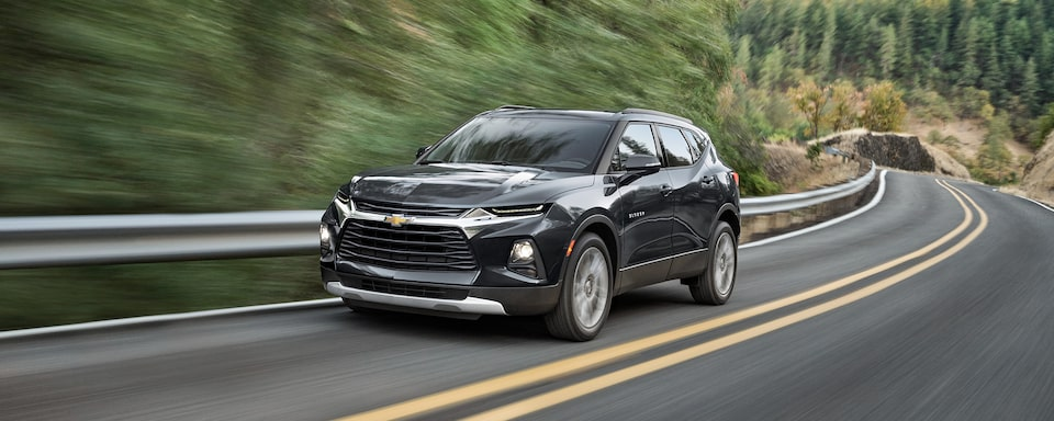 2021 Chevrolet Blazer mid-size SUV: driving around curved road.