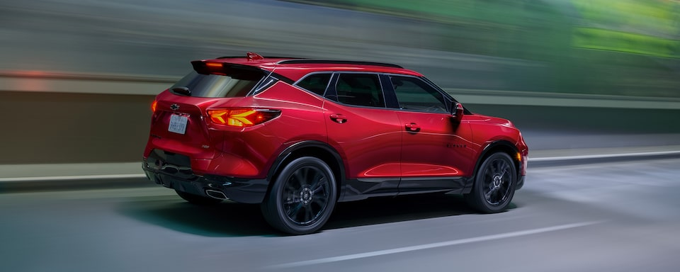 2021 Chevrolet Blazer mid-size SUV: passenger side driving down road.