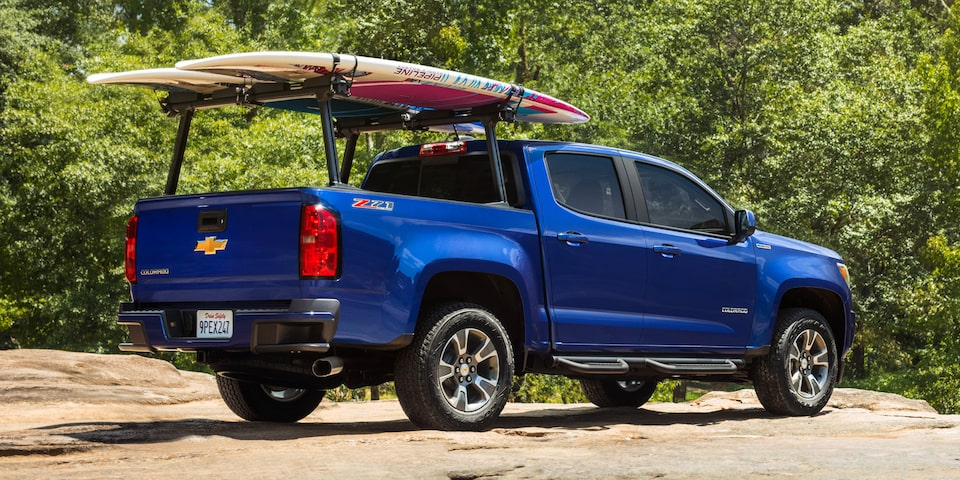 2020 Chevrolet Colorado Mid-Size Truck With Rear Cargo Rack And Surf Boards.