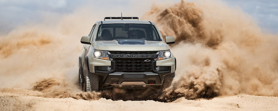 2021 Chevrolet Colorado Mid-Size Pickup Truck Running On Sand.